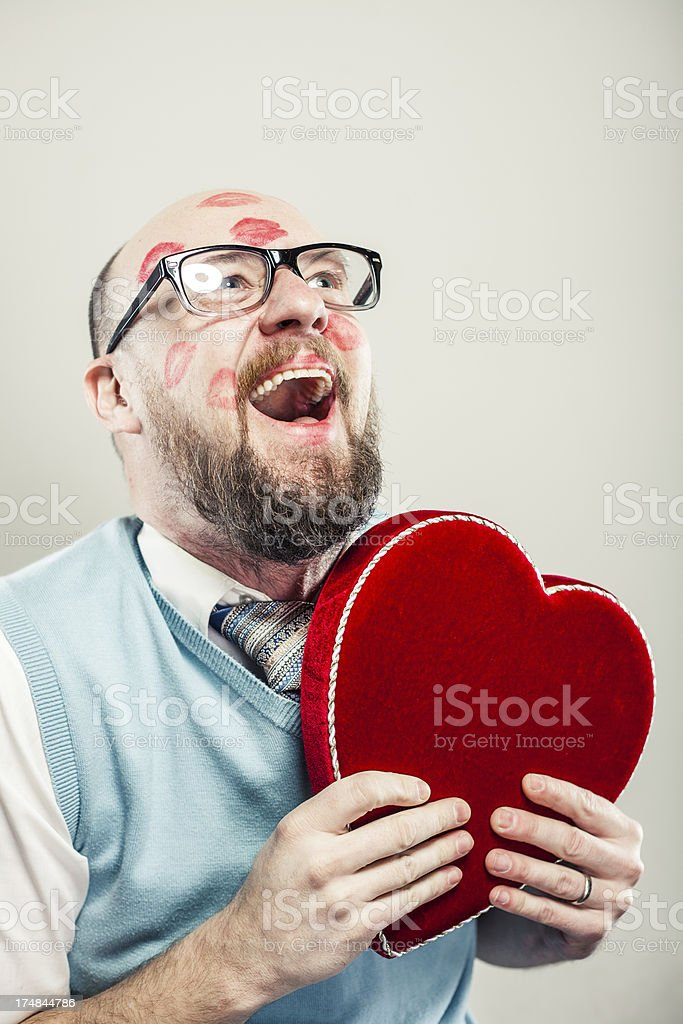 Hilarious Nerd Guy Laughing Holding Heart Shape royalty-free stock photo