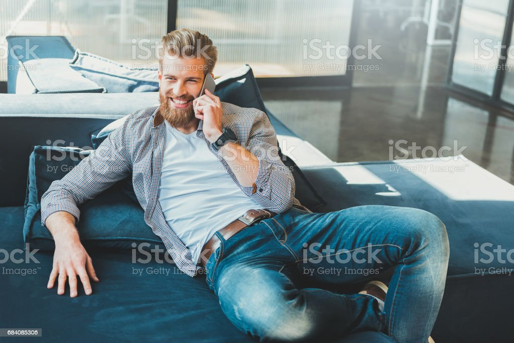 Hilarious smiling office worker in bureau resting stock photo