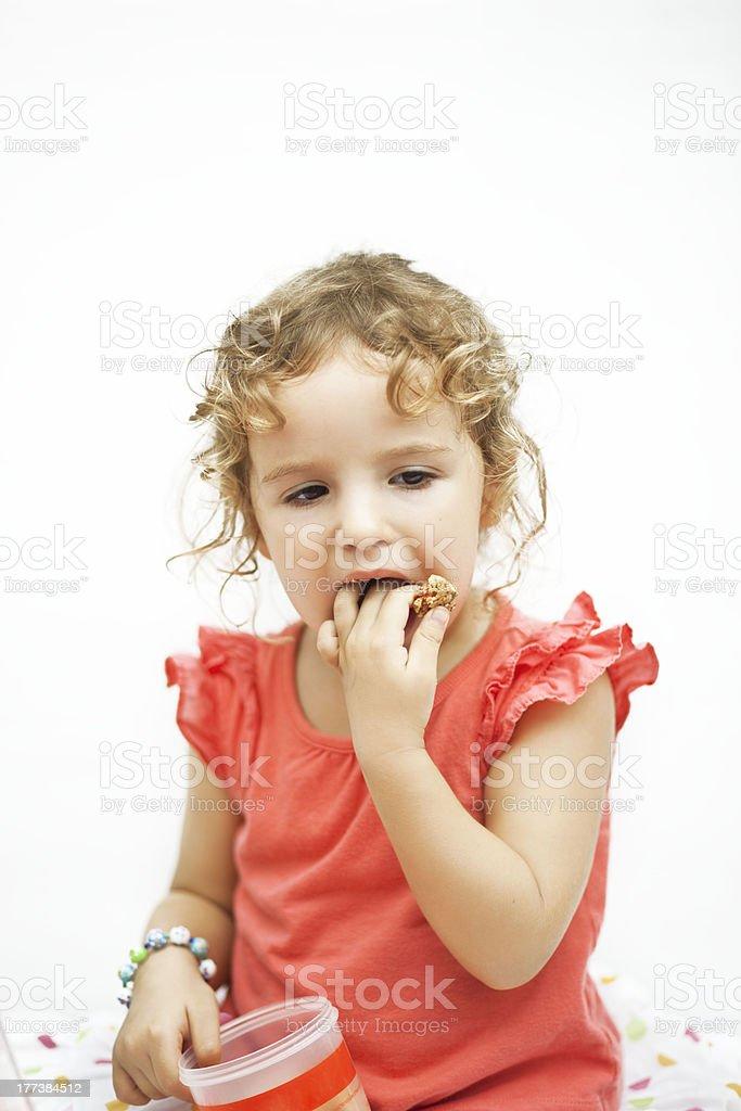 Сhild eats fruit crisps stock photo