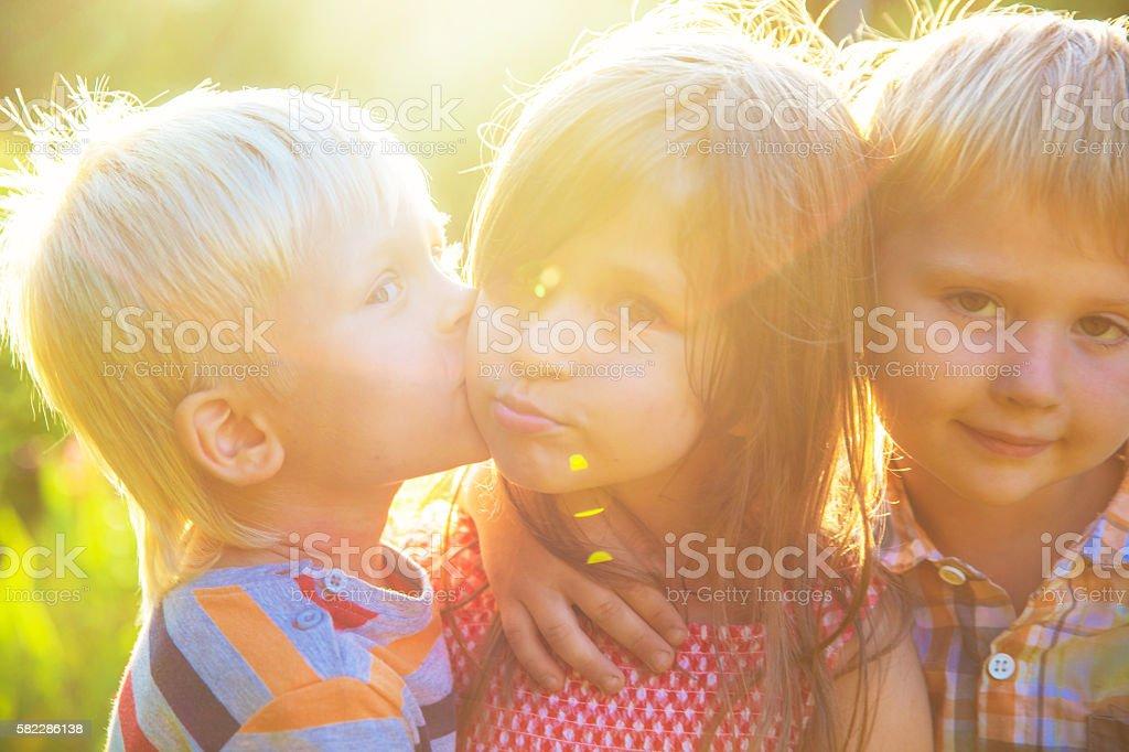 Сhildren kissing stock photo