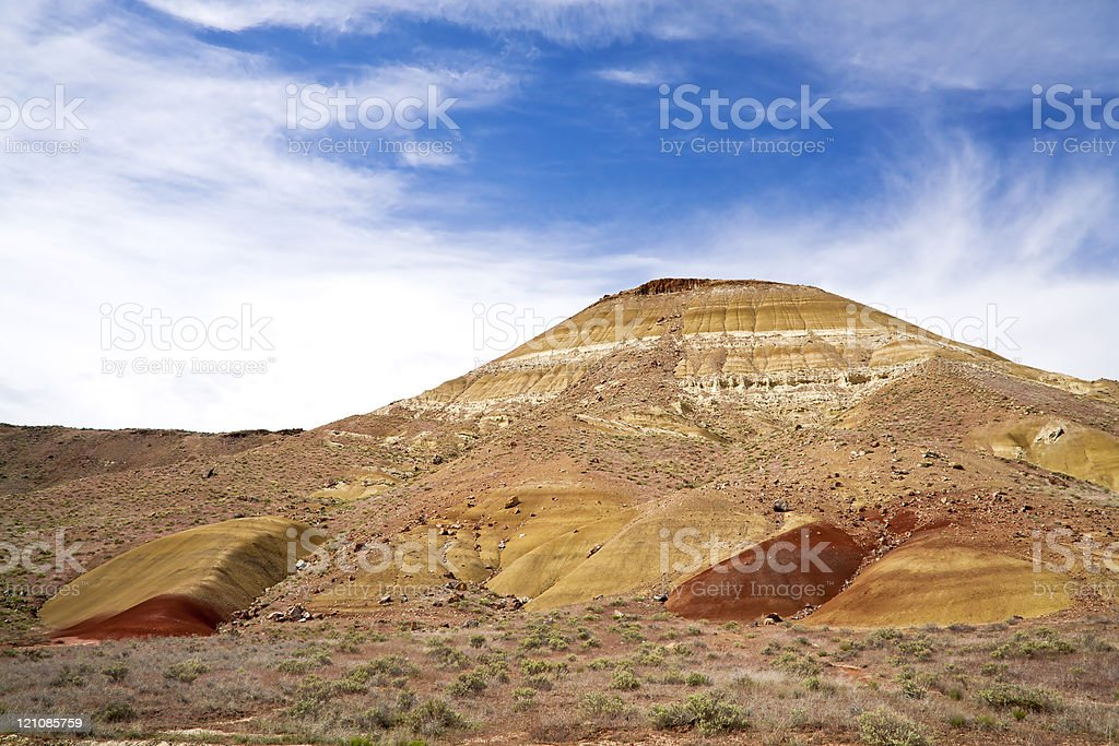 Hill against blue sky. stock photo