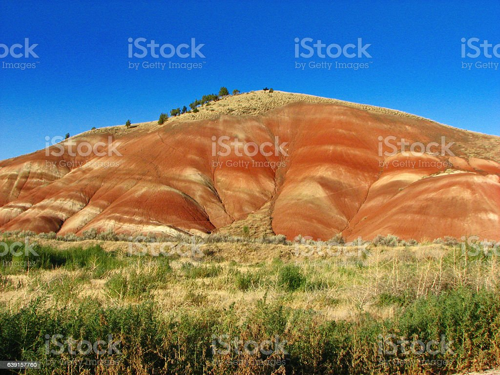 Hill at Painted Hills Oregon on a clear sunny day stock photo