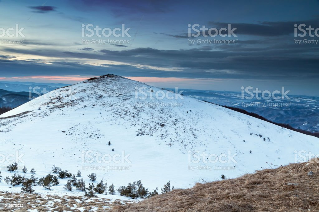 Hill covered whit snow in the mountain stock photo