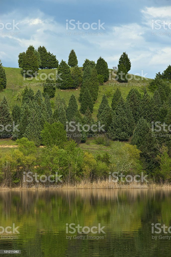 Hill over the lake stock photo