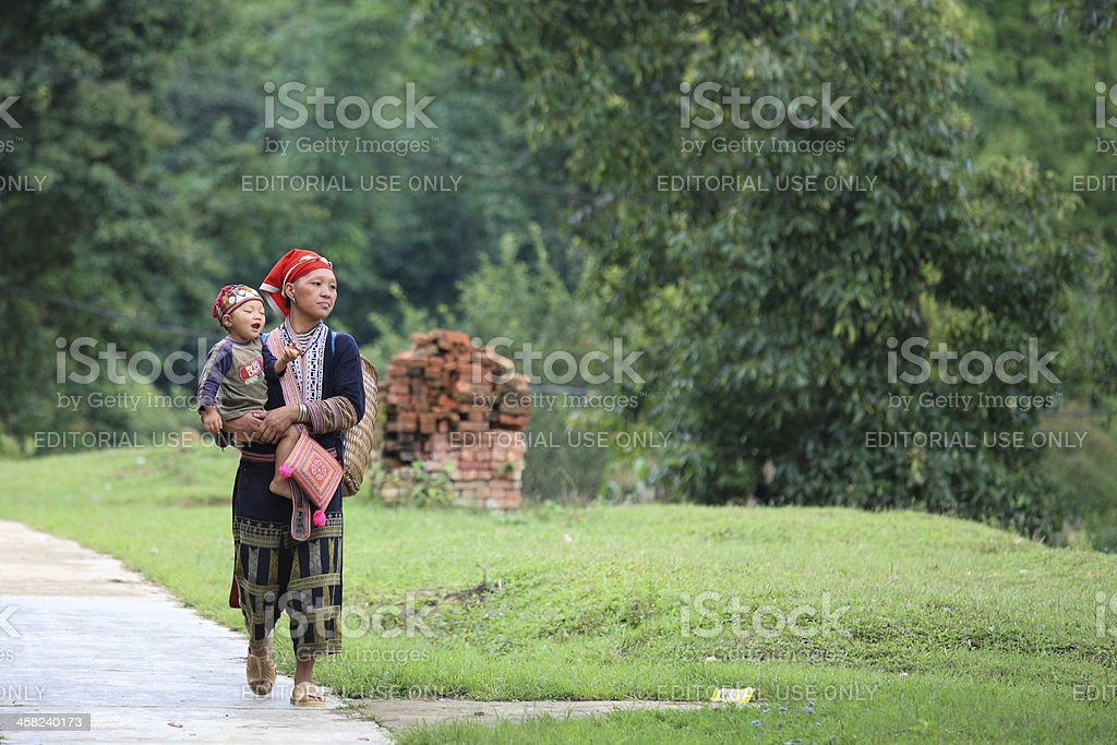 hill tribe mother with her son from Red Dao Minority royalty-free stock photo