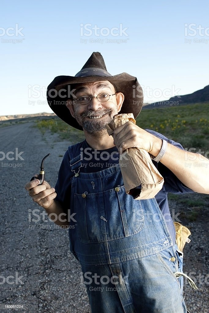 Hillbilly with Bottle of moonshine royalty-free stock photo