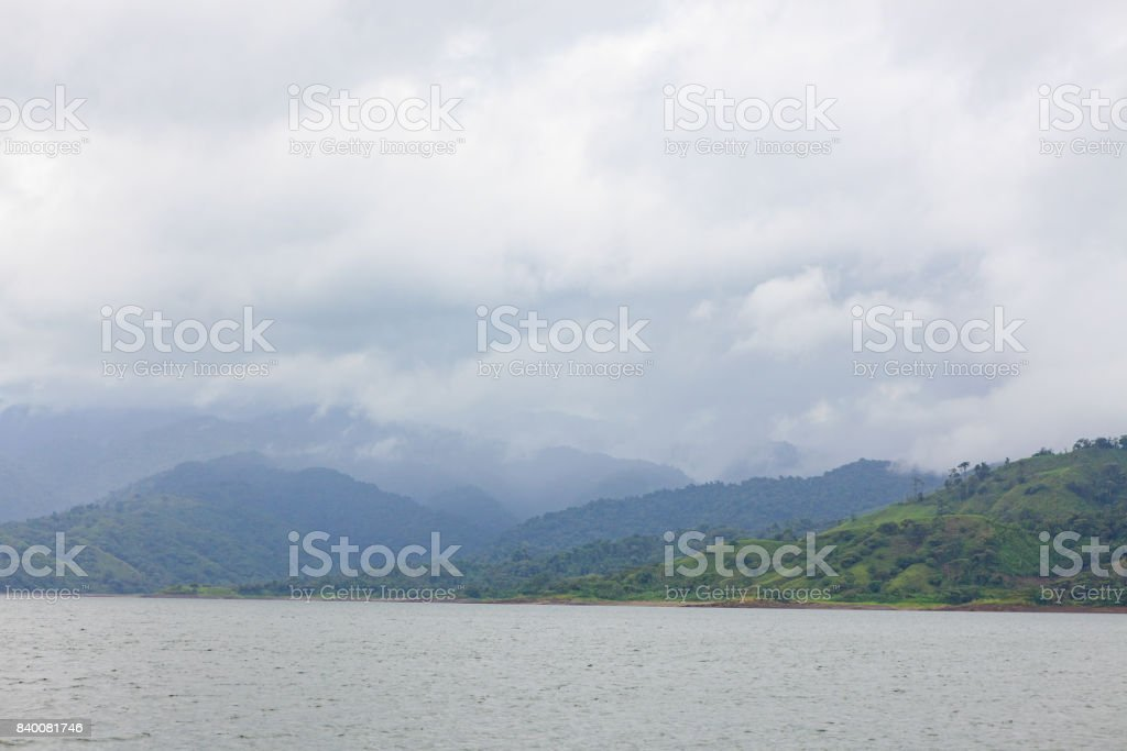 Hills and forest at lake arenal Costa Rica stock photo