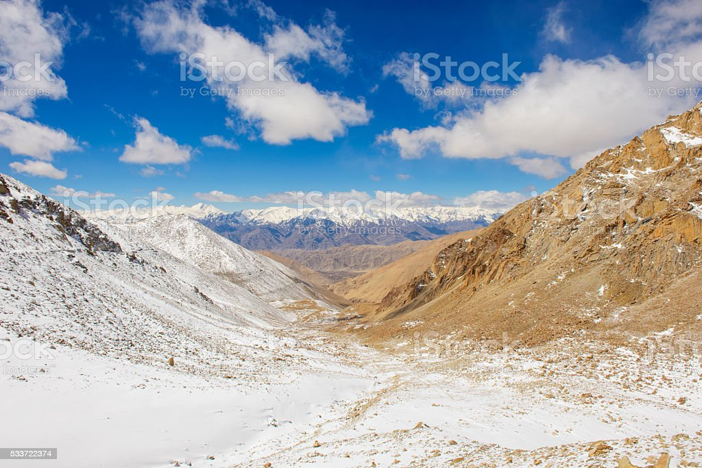 Hills of sand and snow mountain stock photo
