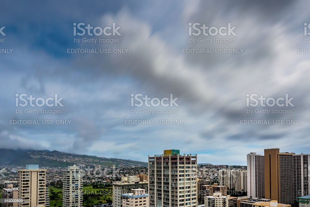 Hillside view with dramatic clouds stock photo