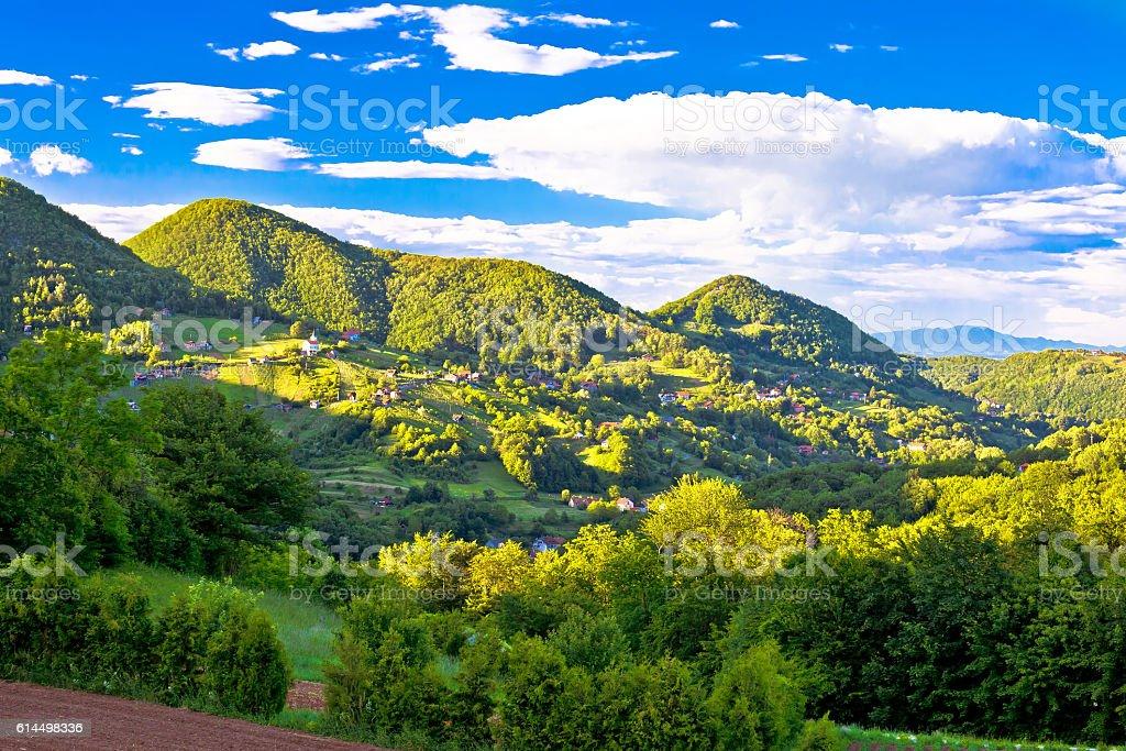 Hillside village on Zumberak green hills stock photo
