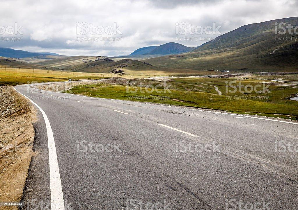 Hillside, winding road. stock photo