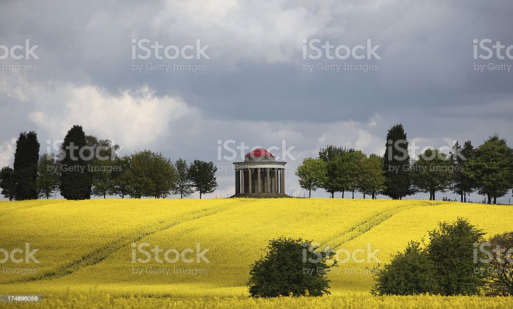 Hilltop folly in English springtime landscape royalty-free stock photo