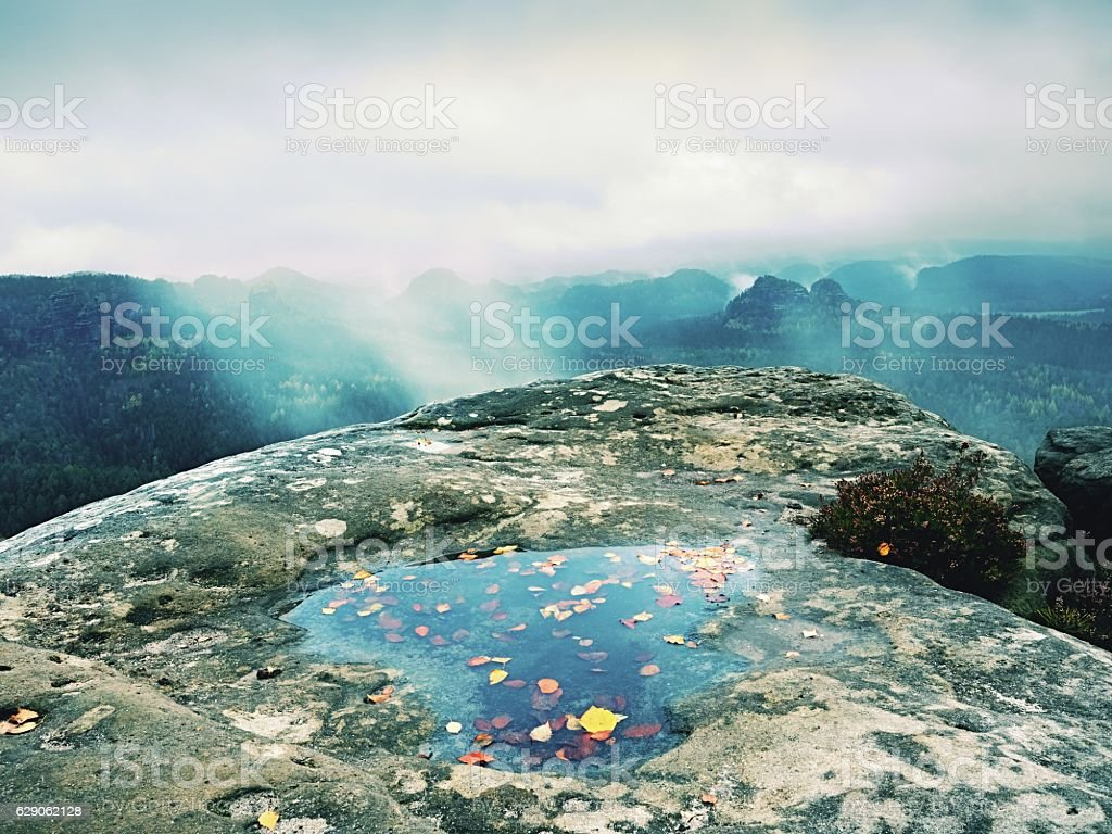 Hilly landscape in water mirror. Misty mountains  after rainy night stock photo