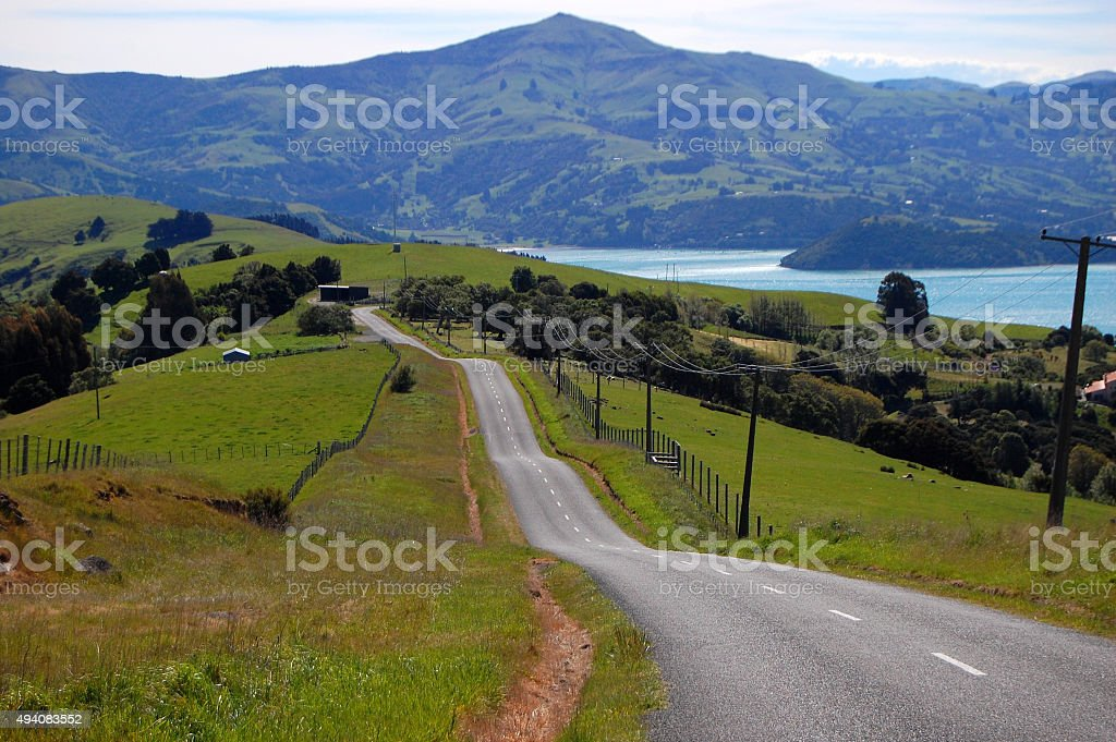 Hilly road in farm area stock photo