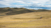 Hilly Steppe landscape, blue sky with clouds.  in Siberian