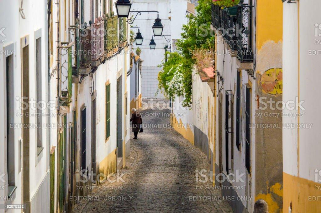 Hilly street in Evora, Portugal stock photo