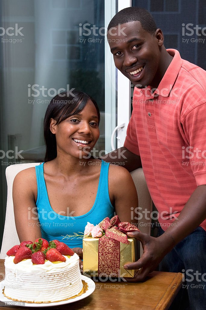 Him Giving Her a Gift royalty-free stock photo