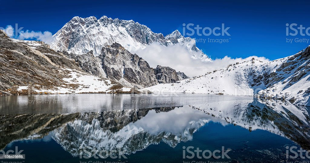 Himalaya mountain peaks reflecting high snowy summits in tranquil lake stock photo