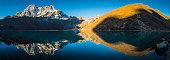 Himalaya mountain peaks reflecting in tranquil Gokyo Lake panorama Nepal