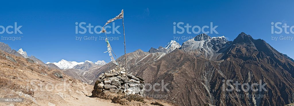 Himalaya prayer flags mani stones mountain peaks panorama Khumbu Nepal stock photo