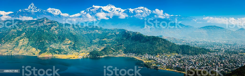Himalayan mountain peaks overlooking Pokhara Annapurna Phewa Lake panorama Nepal stock photo