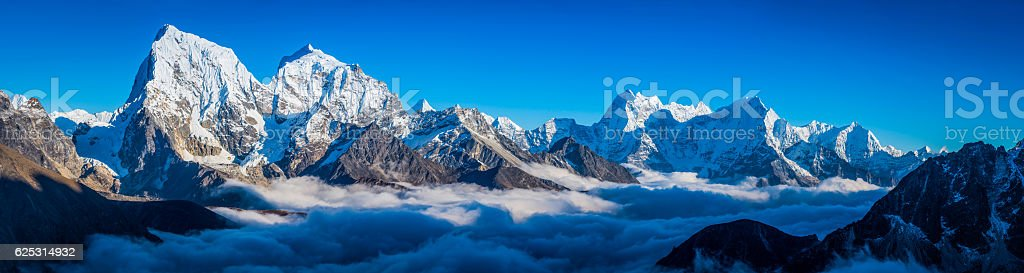 Himalayan mountain peaks panorama above the clouds Solu Khumbu Nepal stock photo