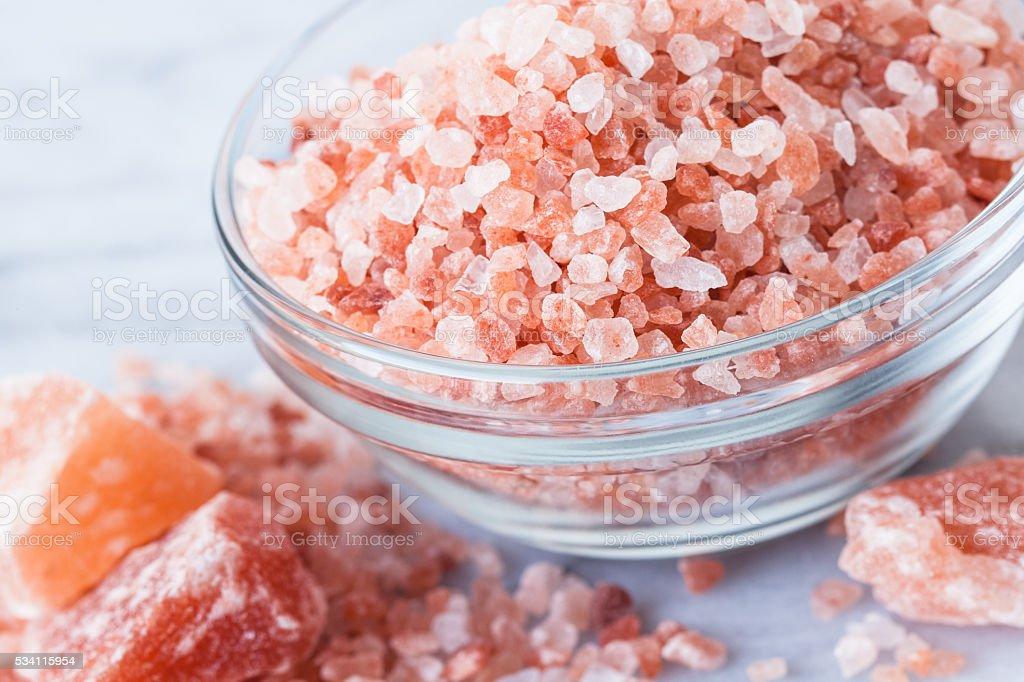 Himalayan Pink Salt in glass bowl stock photo