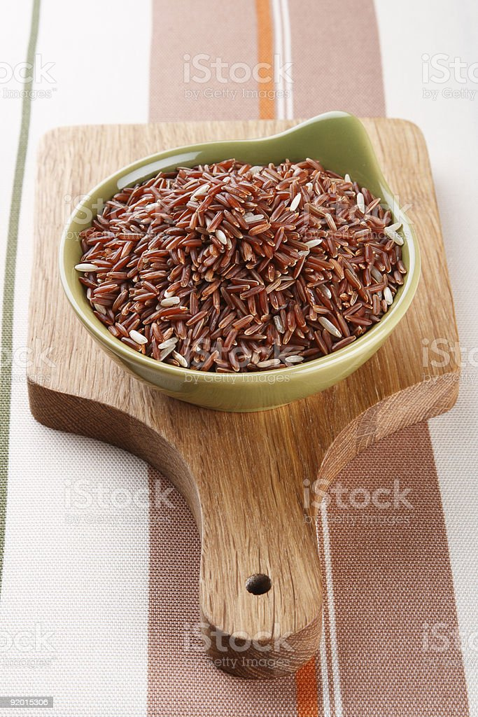 Himalayan Red Long grain Rice in green bowl royalty-free stock photo