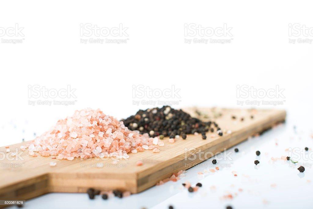 Himalayan rock salt and peppercorns. stock photo