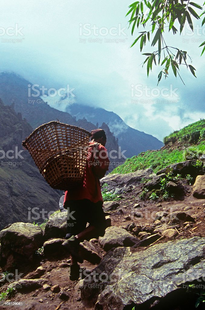 Himalayan Sherpa Climbing Mountain stock photo