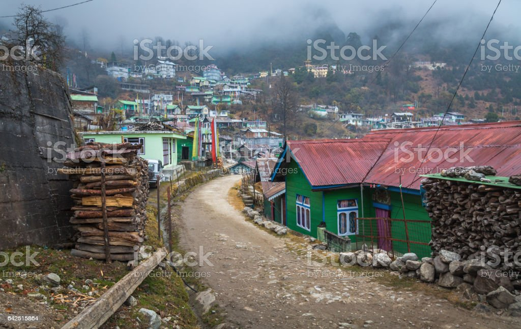 Himalayan town of Lachen Sikkim on a foggy morning. stock photo