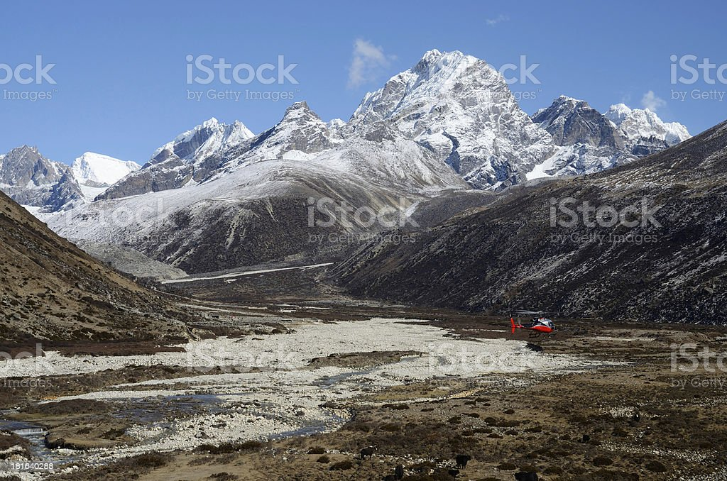 Himalayan valley and rescue helicopter,Nepal, Everest region, Asia royalty-free stock photo