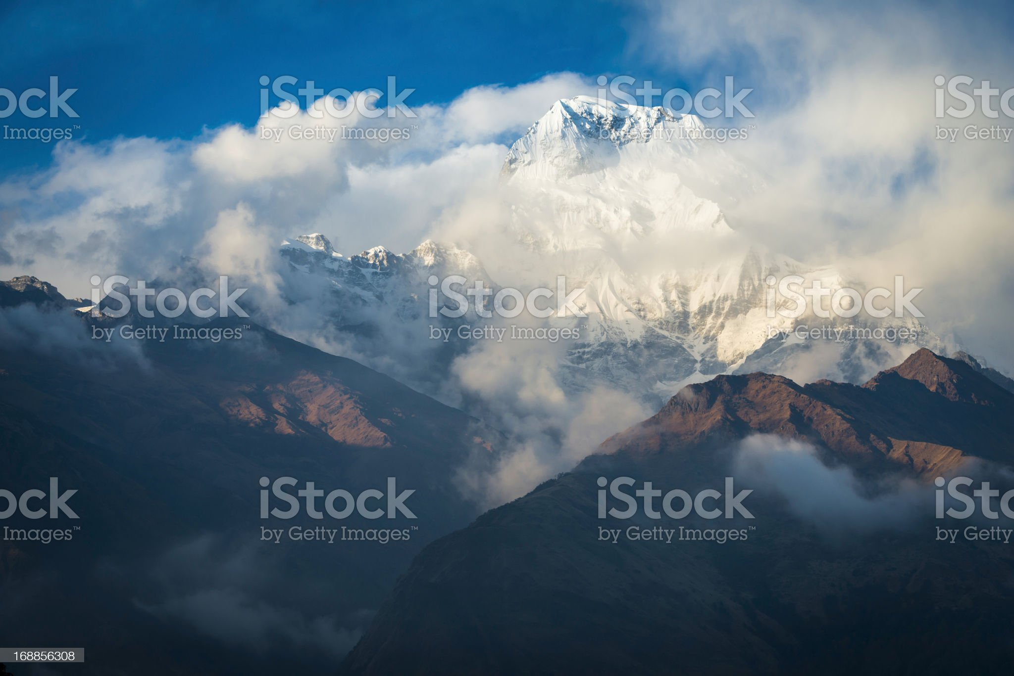 Himalayas clouds swirling around Annapurna snowy peaks Nepal royalty-free stock photo