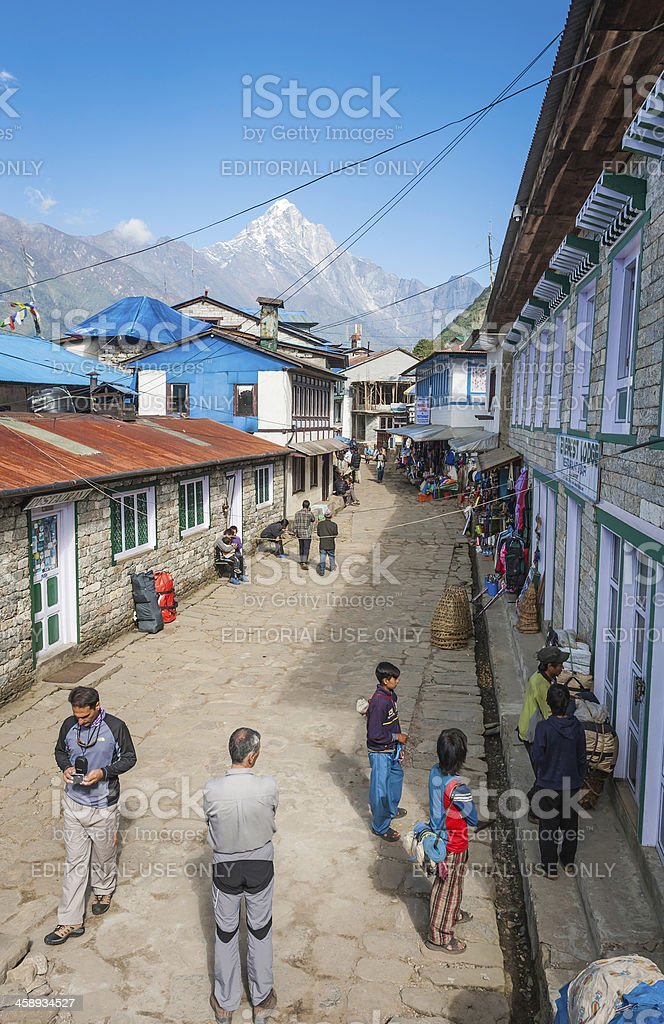Himalayas locals and tourists in Lukla Nepal royalty-free stock photo