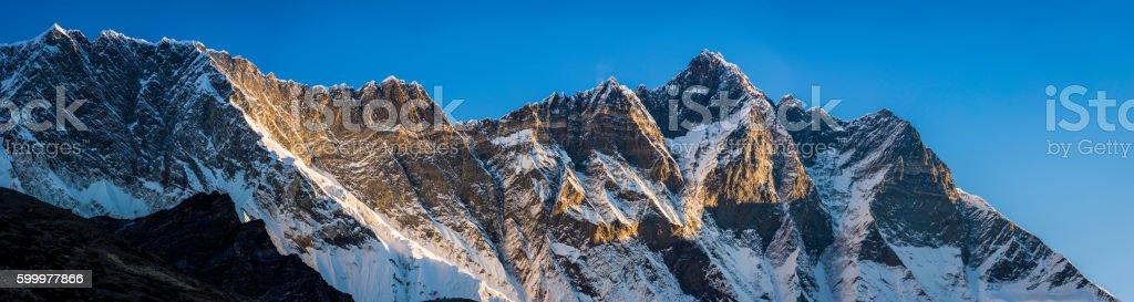 Himalayas mountain peak sunrise Nuptse 7861m Lhotse 8516m panorama Nepal stock photo