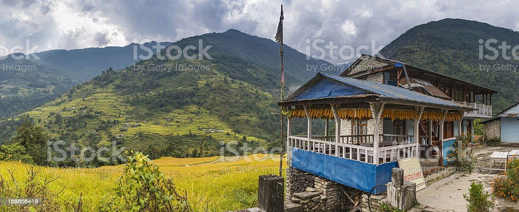 Himalayas traditional teahouse lodge green terraced hills Annapurna Nepal royalty-free stock photo