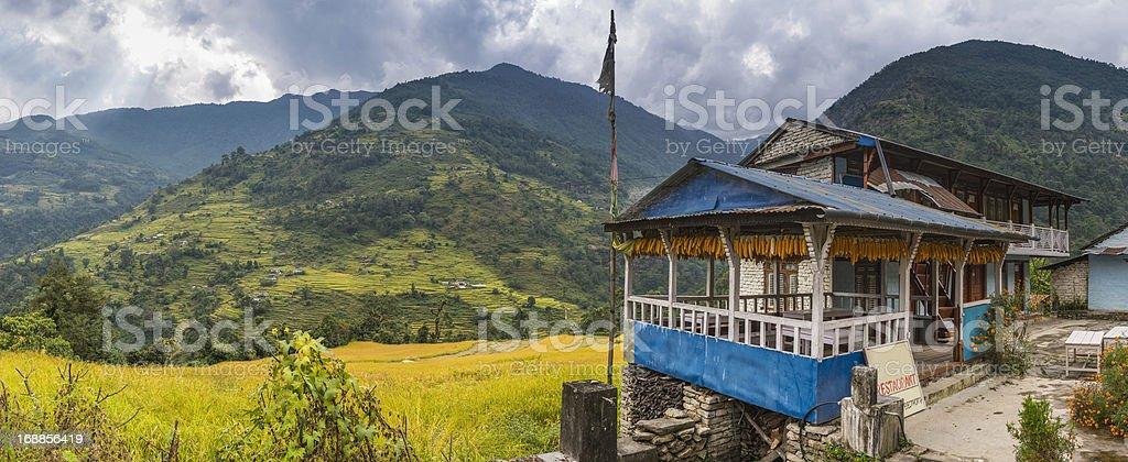 Himalayas traditional teahouse lodge green terraced hills Annapurna Nepal stock photo