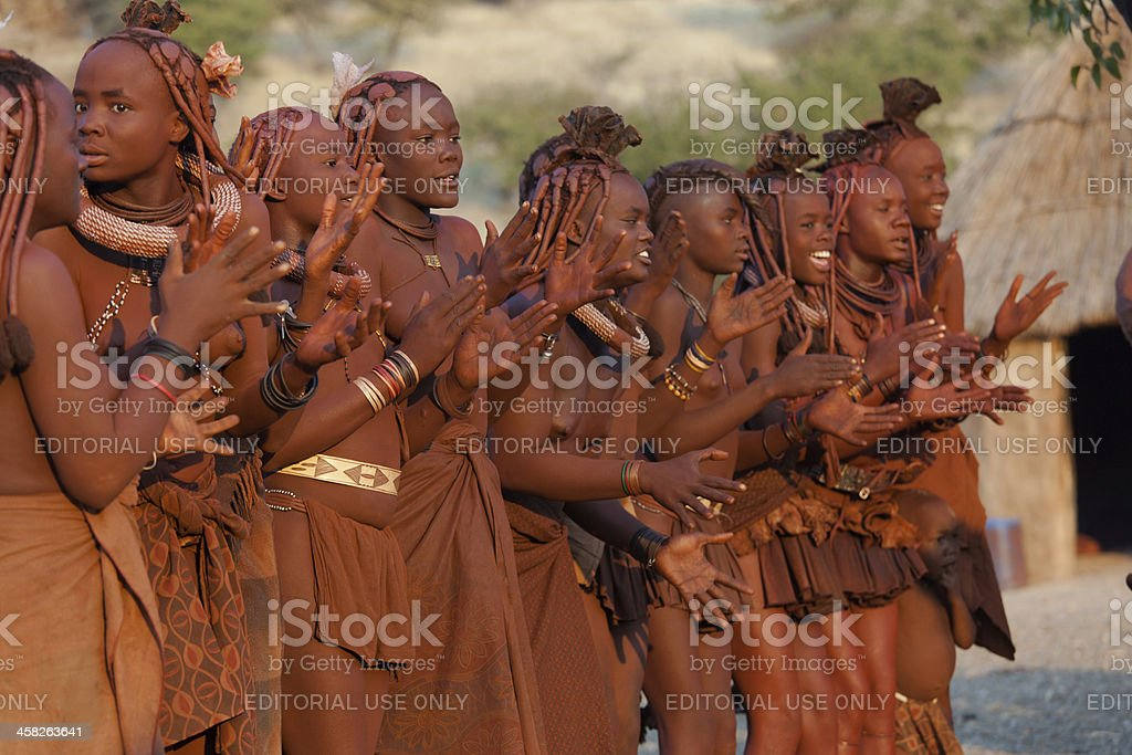 Himba clapping hands stock photo