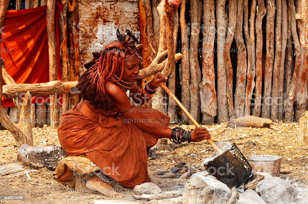 Himba woman cooking in his village near Epupa Falls, Namibia stock photo