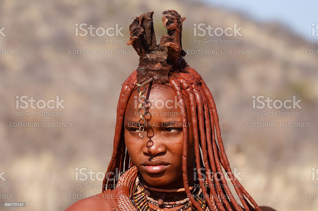 Himba woman with ornaments on the neck in the village stock photo