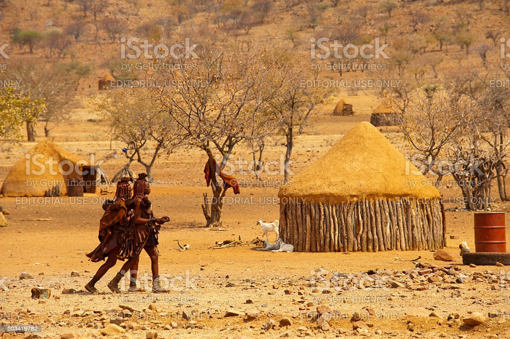Himba womans in their village near Epupa Falls, Namibia. stock photo
