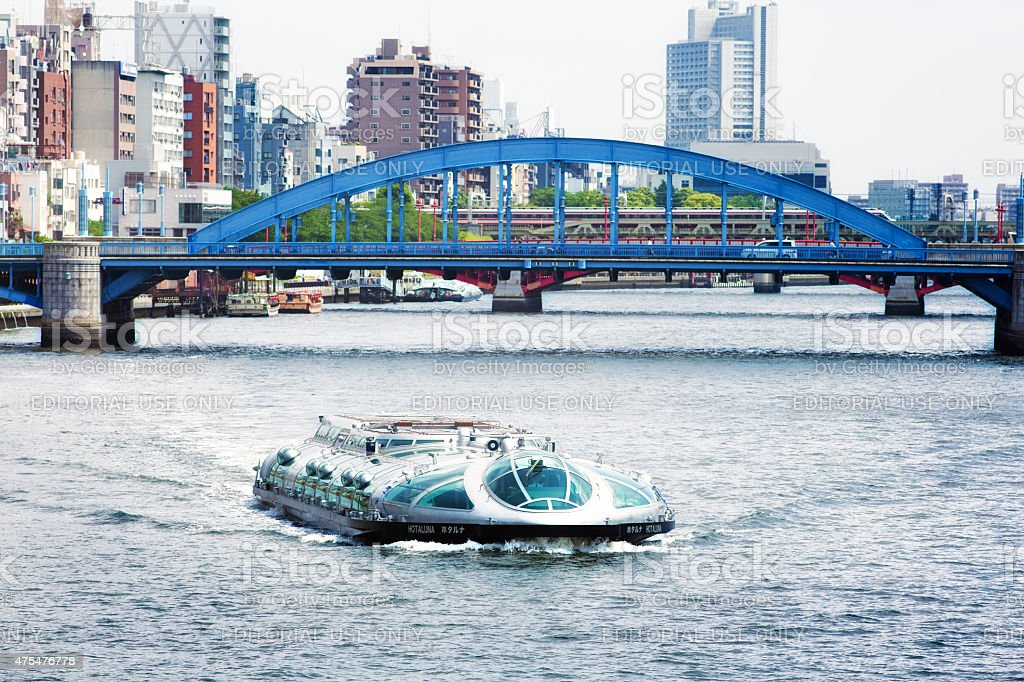 Himiko boat on Tokyo's Simuda river with Komagata bridge stock photo