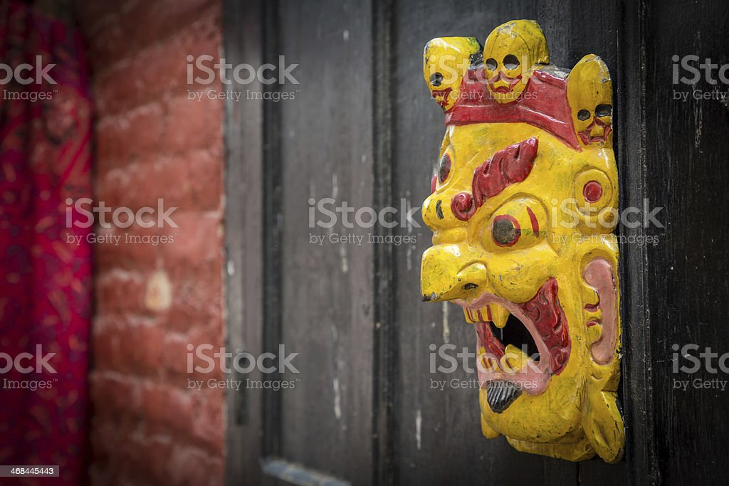 Hindu and Buddhist Wooden Masks in Souvenir Market, Nepal royalty-free stock photo