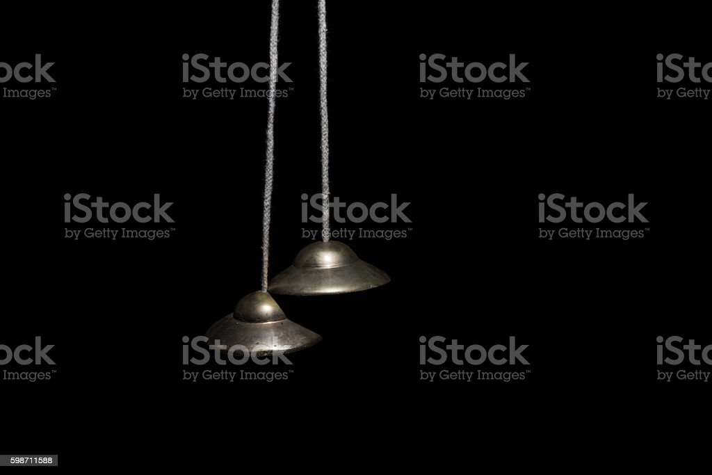 Hindu cymbals on black stock photo