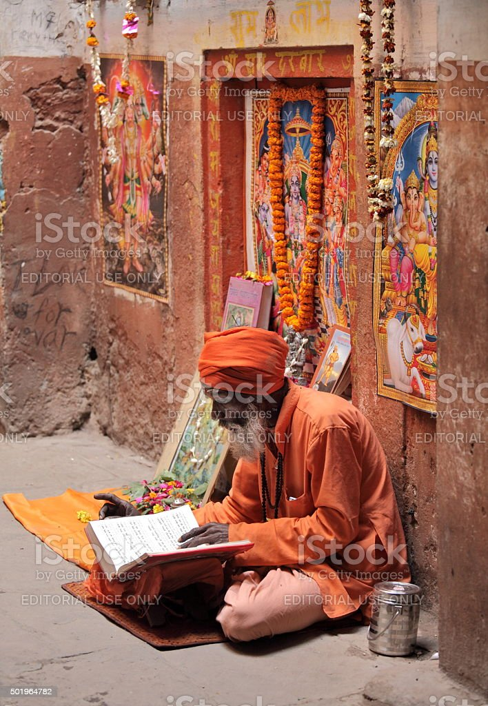 Hindu devotee reads and reciting sacred texts stock photo
