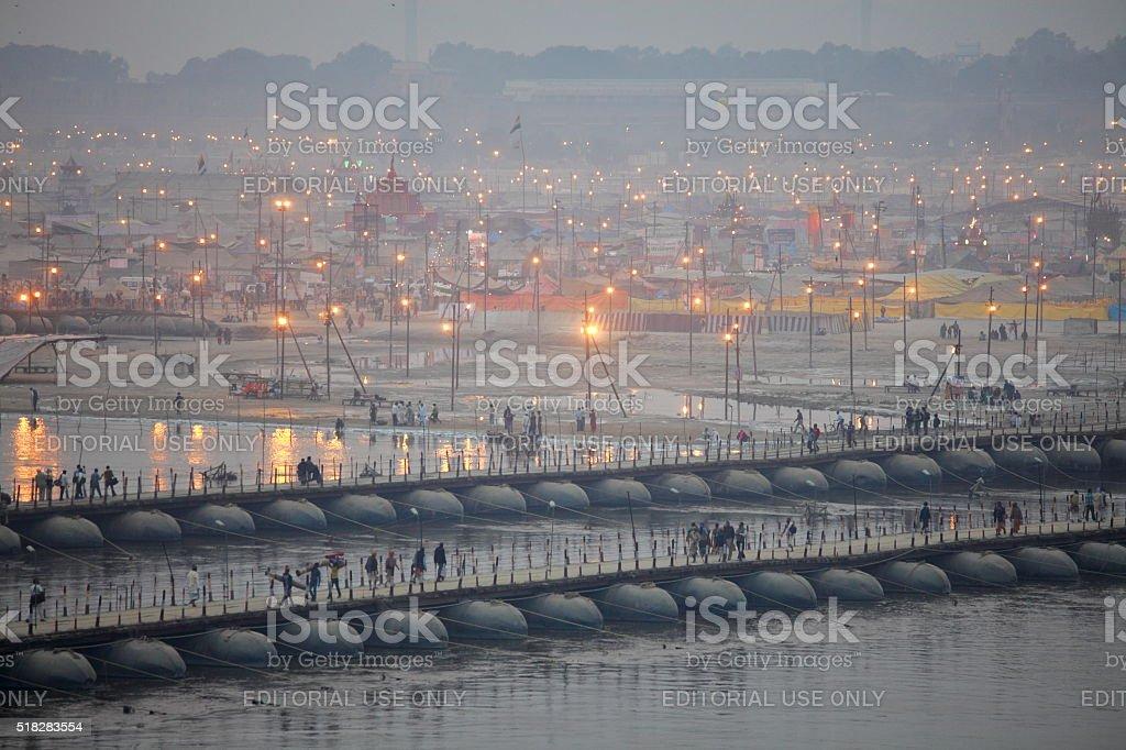 Hindu devotees crossing pontoon bridges over Ganges at Kumbh Mela stock photo