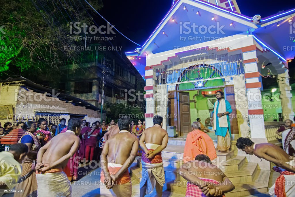Hindu devotees dancing for Charhak festival, for welcoming Bengali new year 1424. stock photo