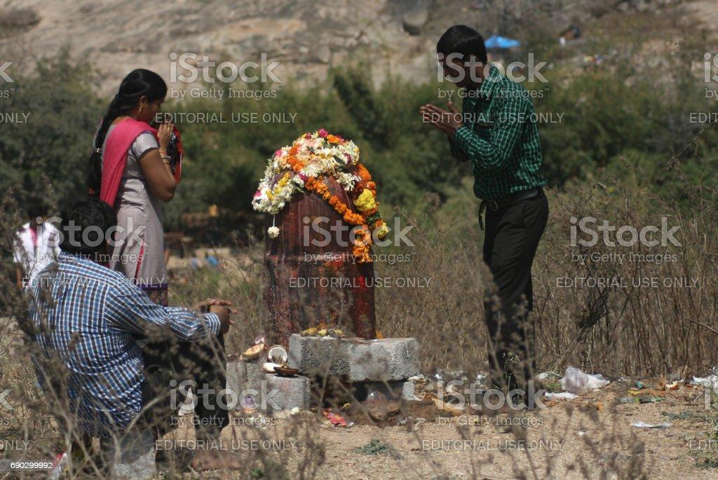 Hindu devotees perform abhishekam to lord shiva statue during Maha siva ratri ,keesaragutta,Hyderabad,India. stock photo