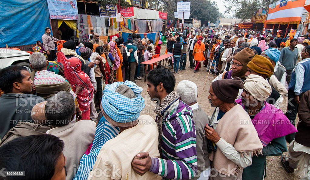 Hindu devotees qued up for food at transit camp stock photo
