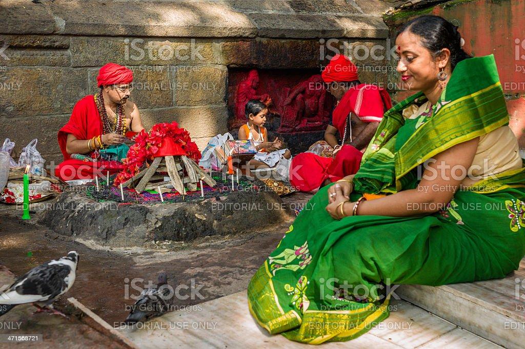 Hindu family performs religious ceremony, Guwahati, Assam, India. royalty-free stock photo